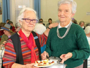 From Left: CWA ladies Rae Baudouin and Margaret Halford serving up delicious scones and cream